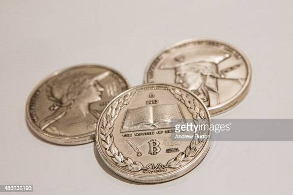 Silver coins with the Bitcoin logo on them are displayed at a Bitcoin conference on at the Javits Center April 7 2014 in New York City Topics...