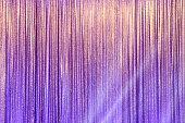 Silver Curtain Screen drape wave and lighting beam around to create colorful change reflection on background