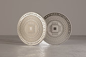 Silver digital crypto-currency coins standing on metal floor as example for virtual currency and fin-tech