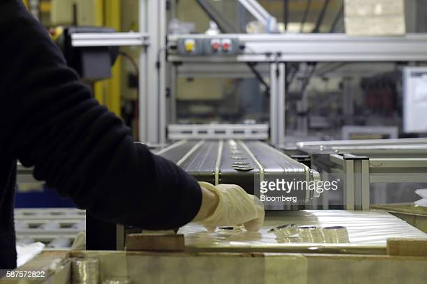 Silver discs are checked before being sent to the minting room at the Perth Mint in Perth Australia on Thursday Aug 4 2016 The Perth Mint refines all...