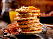 Whole Wheat Pancakes with Maple Syrup and Butter -Photographed on a Hasselblad H3D11-39 megapixel Camera System