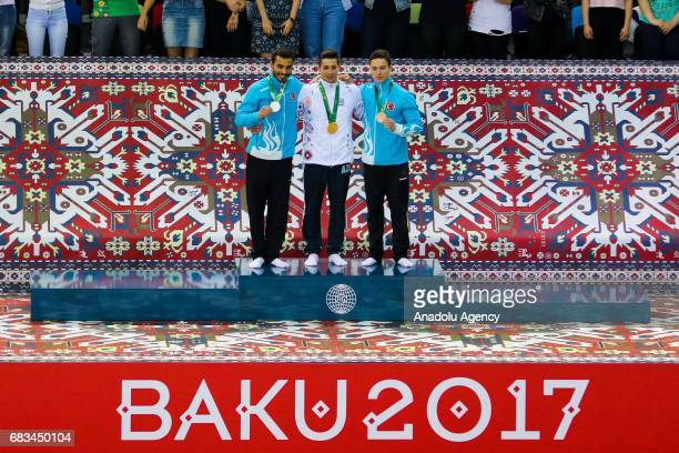 Silver Ferhat Arican of Turkey Gold medallist Bence Talas of Azerbaijan and Bronze medallist Ahmet Onder of Turkey pose on the podium following the...