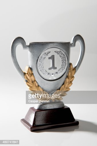 A silver first place trophy with gold laurel wreath embellishment