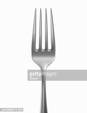 Silver fork on white background, close-up