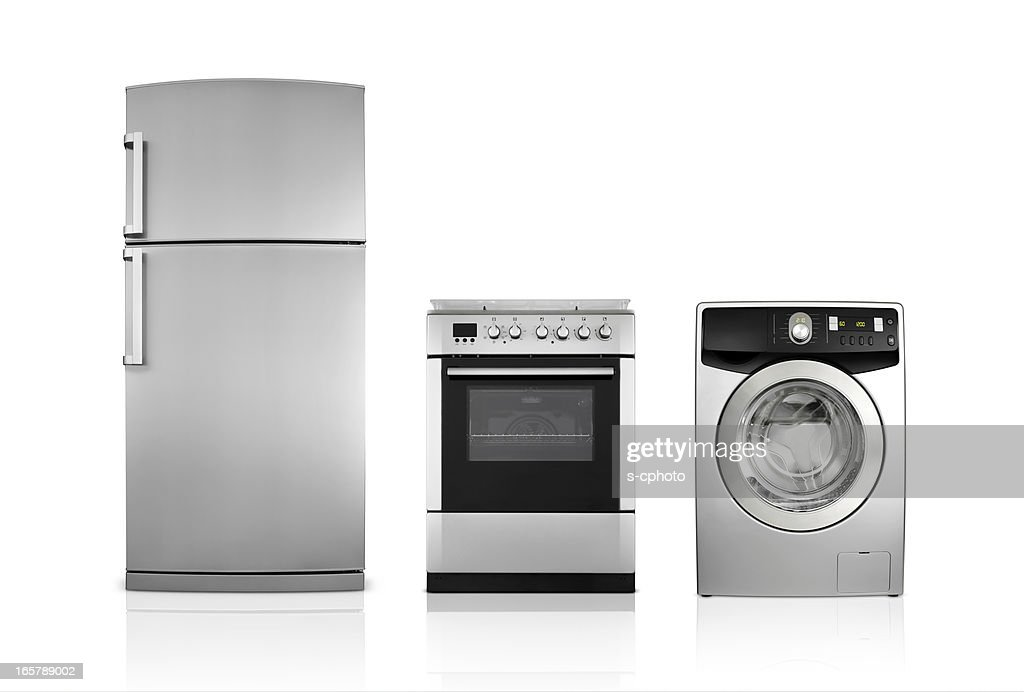 A silver fridge, an oven and dryer lined up side by side