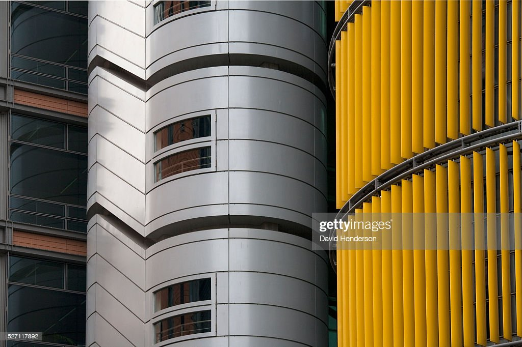 Silver, gold and black skyscraper : Stock Photo