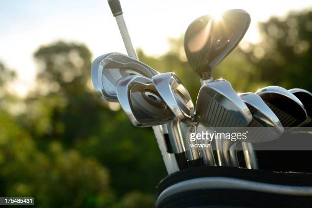 Silver golf clubs reflecting sun light
