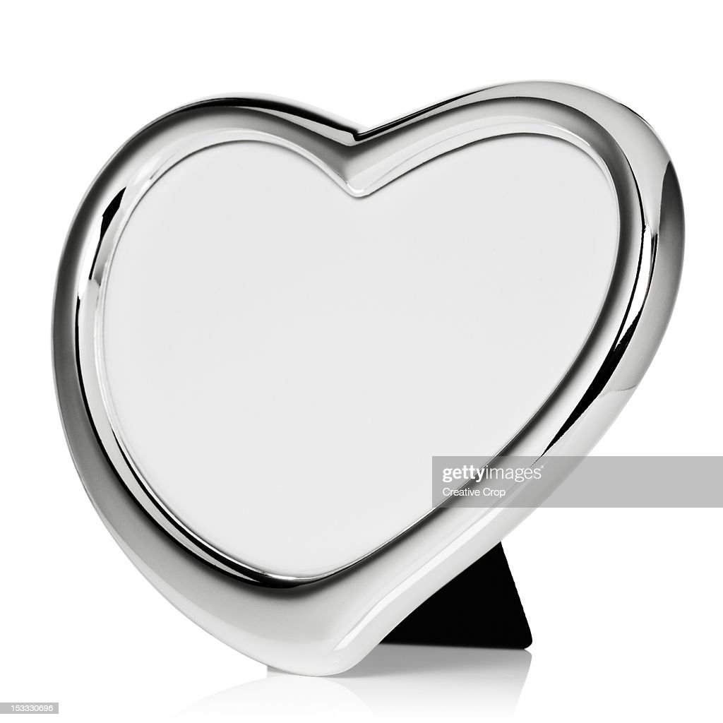 Silver heart shaped photo frame : Stock Photo