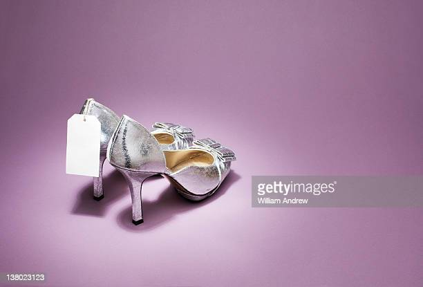 Silver high heels with price tag
