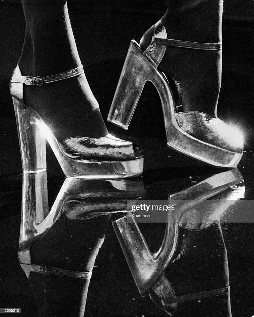 Silver kid platform shoes with perspex heels selling for about ?25,. Seen at the opening of 'The Chelsea Cobbler' at the 'Way In', Harrods, London.
