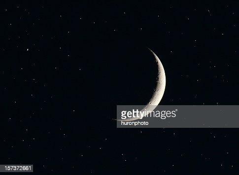 Silver last quarter moon and black sky
