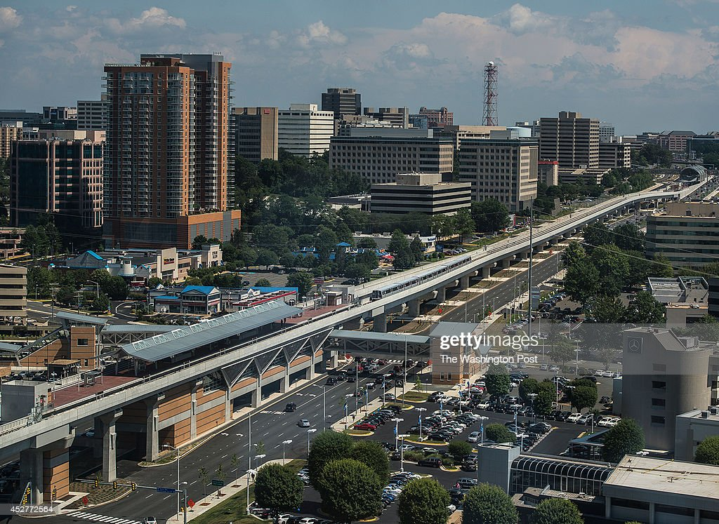 A silver line train approaches at The Spring Hill Station on Saturday July 26 2014 in Reston VA Silver Line adds five new stations along an 117 mile...