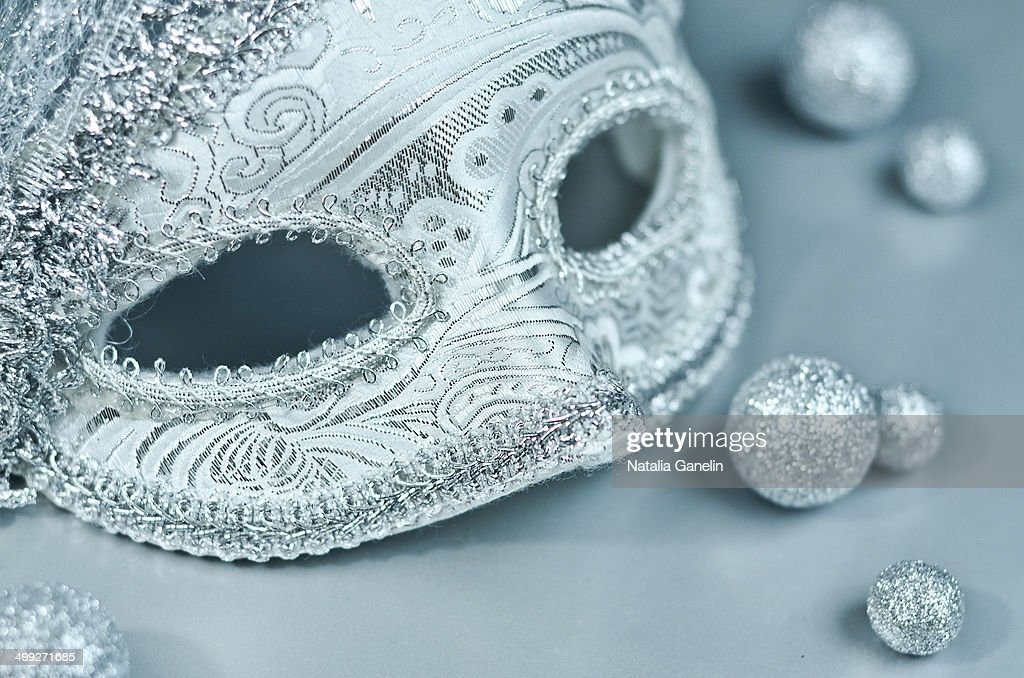 Silver mask on grey background