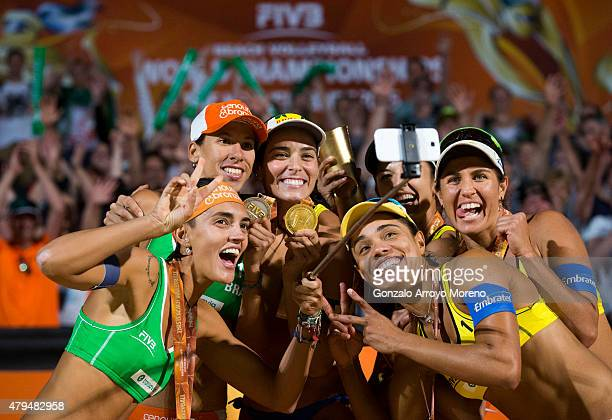 Silver medal Fernanda Alves from Brazil does a selfie with her teammate Taiana Lima gold medal winners Agatha Bednarczuk and Barbara Seixas de...