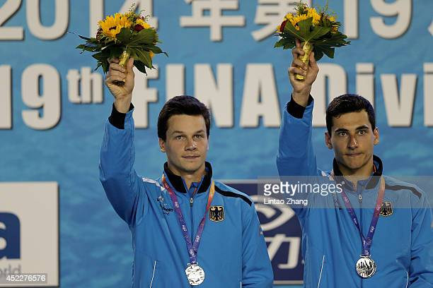 Silver medal Stephan Feck and Patrick Hausding of Germany celebrate during the medal ceremony for the men's 3m Synchro Springboard Final during day...