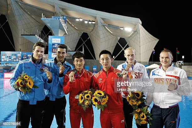 Silver medal Stephan Feck and Patrick Hausding of Germany gold medallists Lin Yue and Cao Yuan of China and Ilya Zakharov and Evgeny Kuznetsov of...
