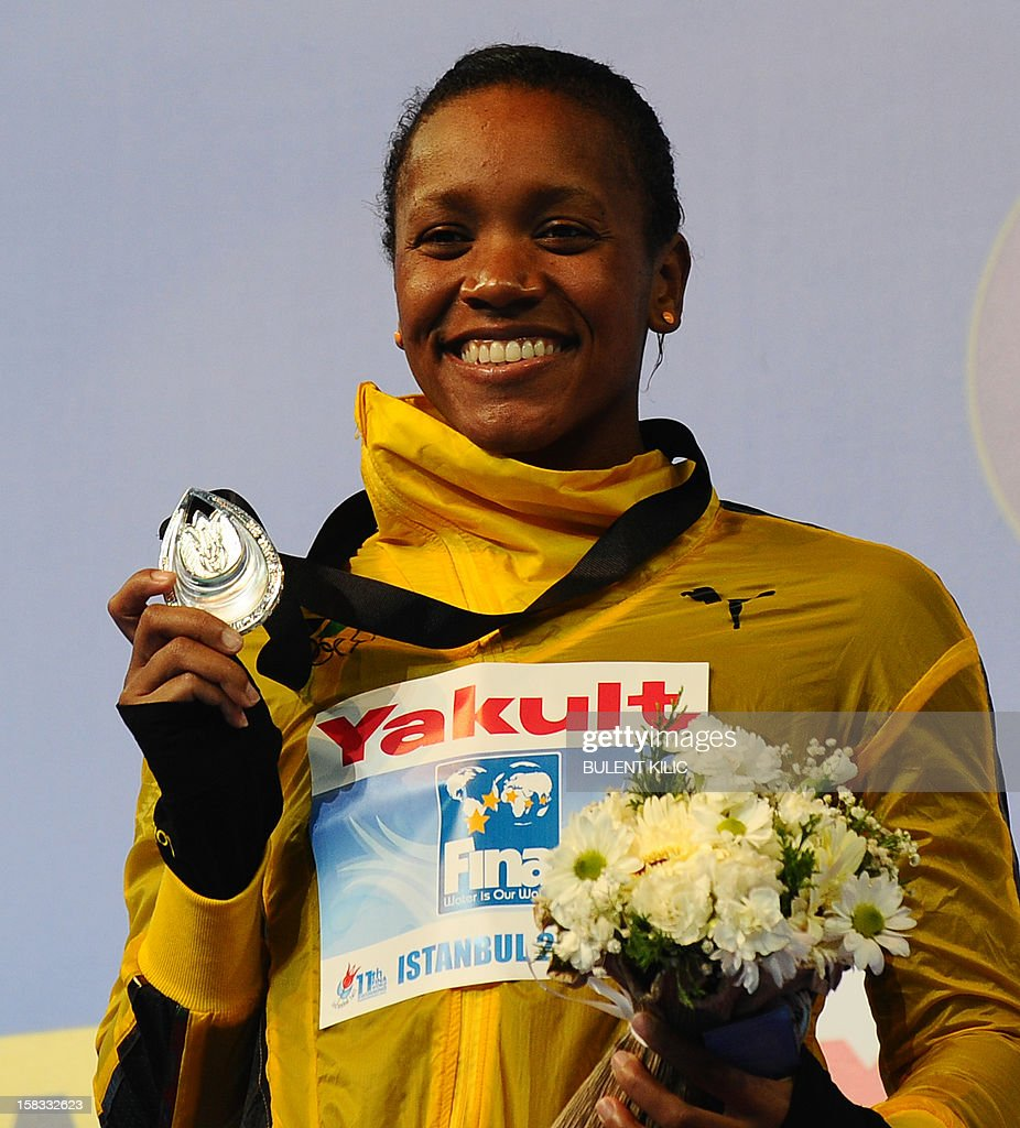 Silver medal winner Alia Atkinson (L) of Jamaica poses after the women`s 50m breasttroke on December 13, 2012 of the FINA World Short Course Swimming Championships in Istanbul.