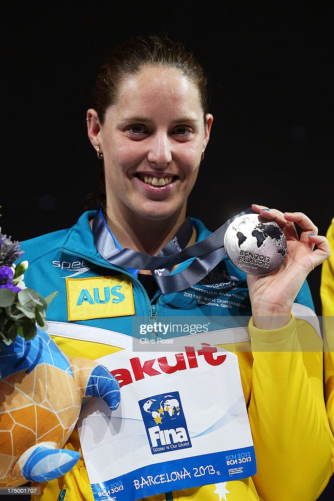 Silver medal winner Alicia Coutts of Australia celebrates on the podium after the Swimming Women's 100m Butterfly Final on day ten of the 15th FINA World Championships at Palau Sant Jordi on July 29, 2013 in Barcelona, Spain.