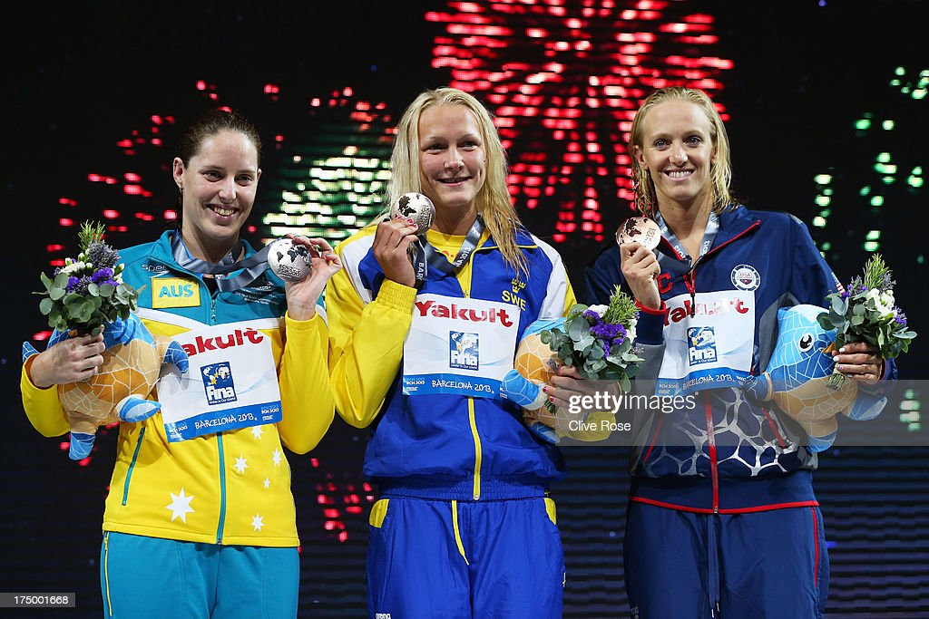 Silver medal winner <a gi-track='captionPersonalityLinkClicked' href=/galleries/search?phrase=Alicia+Coutts&family=editorial&specificpeople=2905127 ng-click='$event.stopPropagation()'>Alicia Coutts</a> of Australia, Gold medal winner Sarah Sjostrom of Sweden and bronze medal winner <a gi-track='captionPersonalityLinkClicked' href=/galleries/search?phrase=Dana+Vollmer&family=editorial&specificpeople=240582 ng-click='$event.stopPropagation()'>Dana Vollmer</a> of the USA celebrate on the podium after the Swimming Women's 100m Butterfly Final on day ten of the 15th FINA World Championships at Palau Sant Jordi on July 29, 2013 in Barcelona, Spain.