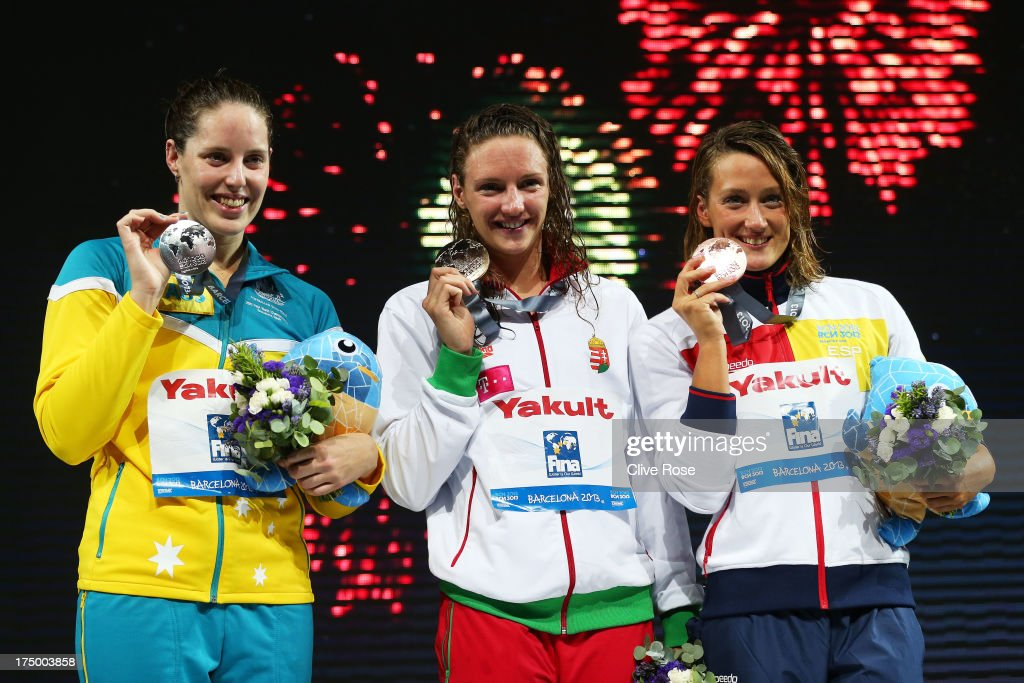 Silver medal winner <a gi-track='captionPersonalityLinkClicked' href=/galleries/search?phrase=Alicia+Coutts&family=editorial&specificpeople=2905127 ng-click='$event.stopPropagation()'>Alicia Coutts</a> of Australia, Gold medal winner <a gi-track='captionPersonalityLinkClicked' href=/galleries/search?phrase=Katinka+Hosszu&family=editorial&specificpeople=2124249 ng-click='$event.stopPropagation()'>Katinka Hosszu</a> of Hungary and Bronze medal winner Mirela Belmonte Garcia of Spain celebrate on the podium after the Swimming Women's 200m Individual Medley Final on day ten of the 15th FINA World Championships at Palau Sant Jordi on July 29, 2013 in Barcelona, Spain.