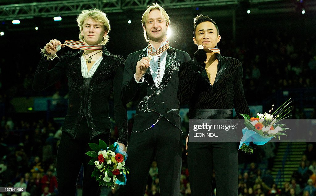 Silver medal winner Artur Gachinski of Russia (L), gold medal winner Evgeni Plushenko of Russia (C) and bronze medal winner Florent Amodio of France (R) stand with their medals following the Mens Free Skating on day six of the ISU European Figure Skating Championships at the Motorpoint Arena in Sheffield, north England, on January 28, 2012.