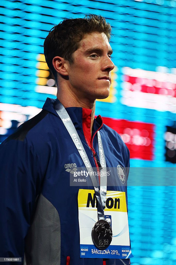Silver medal winner Conor Dwyer of the USA celebrates on the podium after the Swimming Men's 200m Freestyle Final on day eleven of the 15th FINA World Championships at Palau Sant Jordi on July 30, 2013 in Barcelona, Spain.