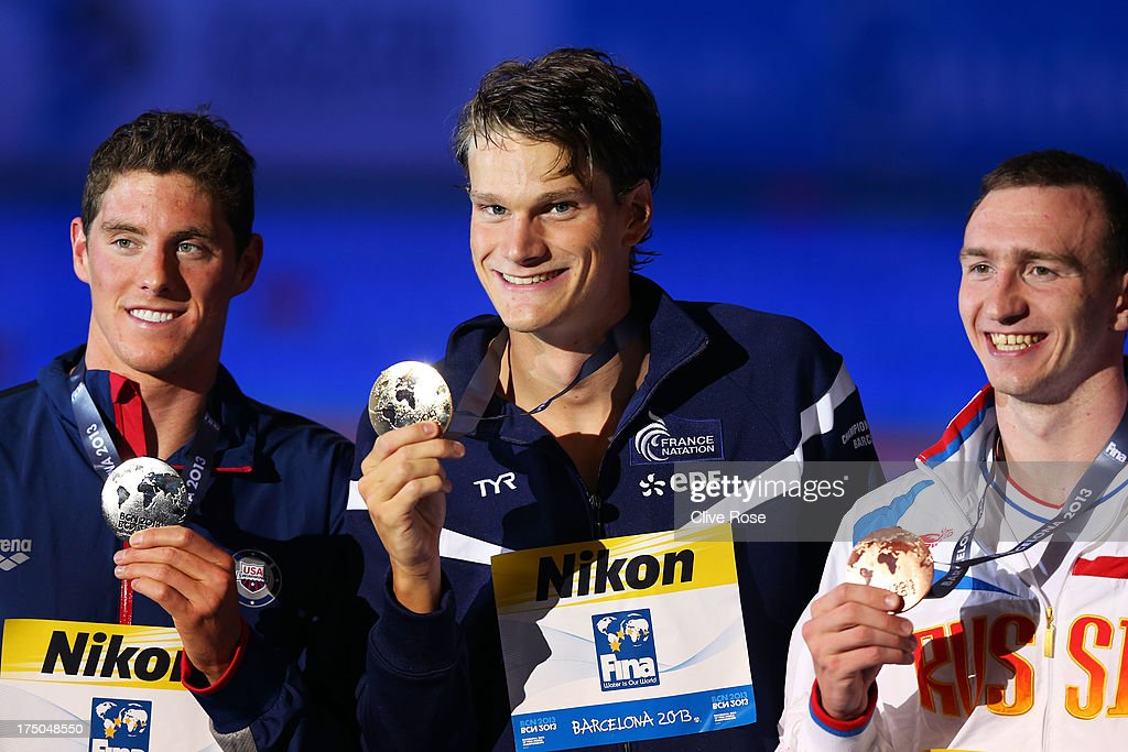 Silver medal winner <a gi-track='captionPersonalityLinkClicked' href=/galleries/search?phrase=Conor+Dwyer&family=editorial&specificpeople=7988001 ng-click='$event.stopPropagation()'>Conor Dwyer</a> of the USA, Gold medal winner <a gi-track='captionPersonalityLinkClicked' href=/galleries/search?phrase=Yannick+Agnel&family=editorial&specificpeople=6567514 ng-click='$event.stopPropagation()'>Yannick Agnel</a> of France and Bronze medal winner <a gi-track='captionPersonalityLinkClicked' href=/galleries/search?phrase=Danila+Izotov&family=editorial&specificpeople=5489189 ng-click='$event.stopPropagation()'>Danila Izotov</a> of Russia celebrate on the podium after the Swimming Men's 200m Freestyle Final on day eleven of the 15th FINA World Championships at Palau Sant Jordi on July 30, 2013 in Barcelona, Spain.