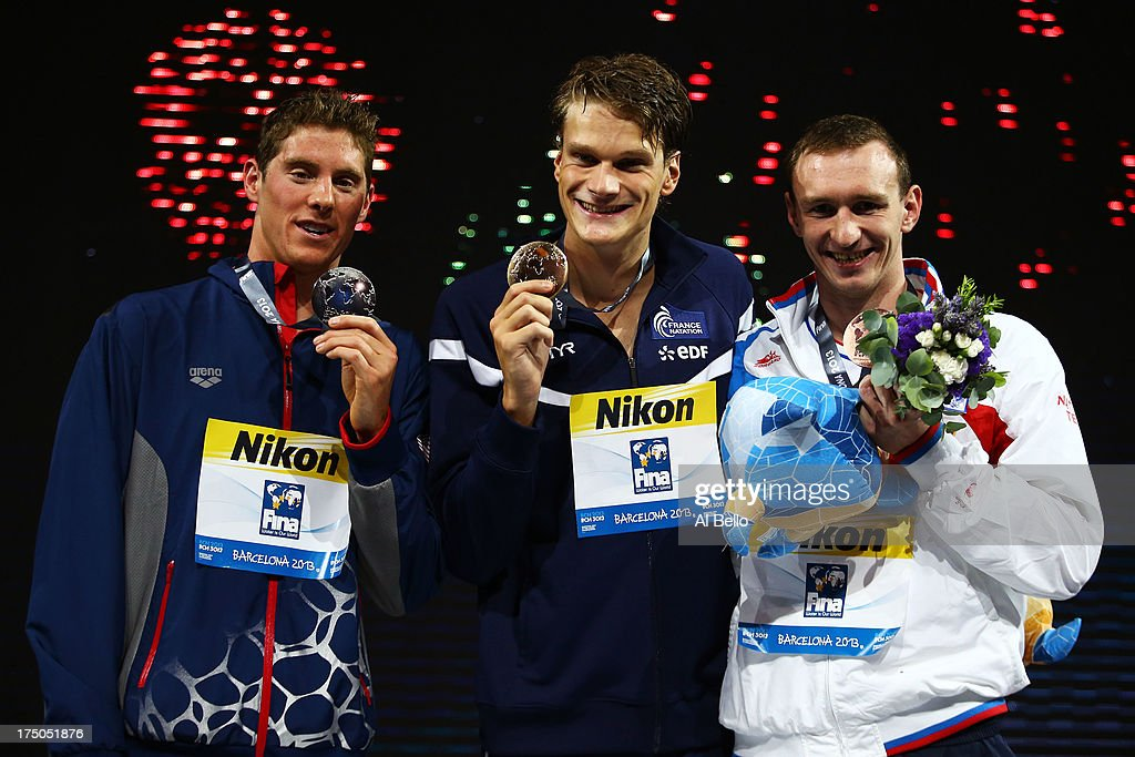 Silver medal winner Conor Dwyer of the USA, Gold medal winner Yannick Agnel of France and Bronze medal winner Danila Izotov of Russia celebrate on the podium after the Swimming Men's 200m Freestyle Final on day eleven of the 15th FINA World Championships at Palau Sant Jordi on July 30, 2013 in Barcelona, Spain.