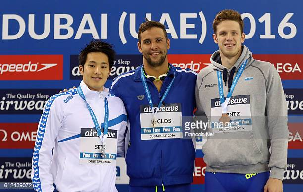 Silver medal winner Daiya Seto of Japan Gold medal winner Chad Le Clos of South Africa and Bronze medal winner Philip Heintz of Germany celebrate on...