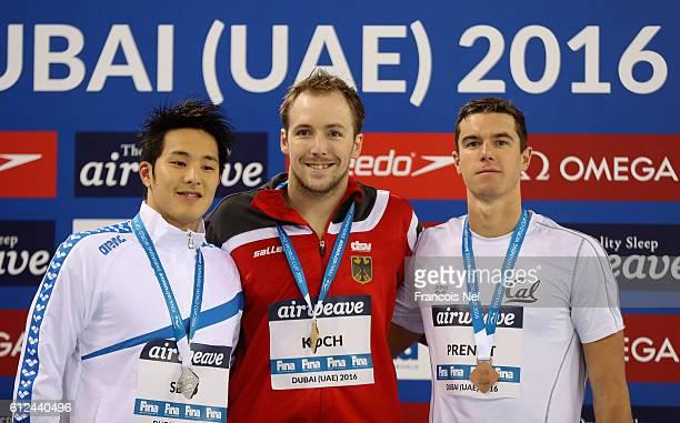 Silver medal winner Daiya Seto of Japan Gold medal winner Marco Koch of Germany and Bronze medal winner Josh Prento of USA celebrate on the podium...