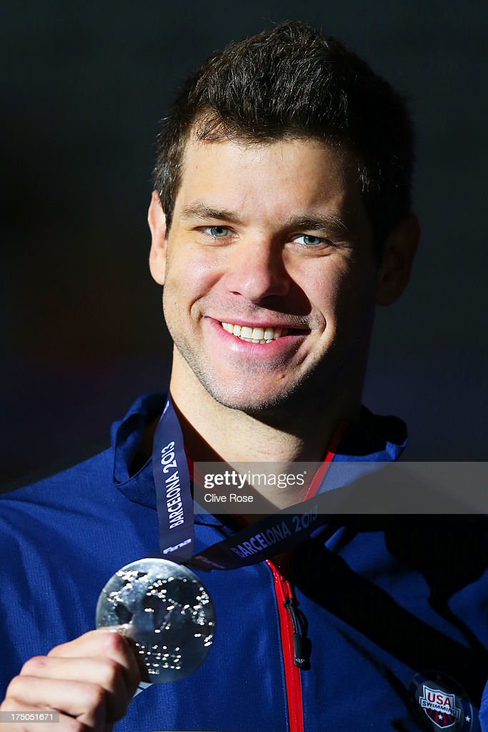 Silver medal winner David Plummer of the USA celebrates on the podium after the Swimming Men's 100m Backstroke Final on day eleven of the 15th FINA World Championships at Palau Sant Jordi on July 30, 2013 in Barcelona, Spain.