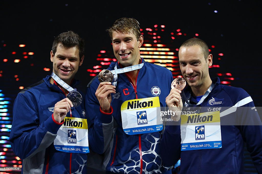 Silver medal winner David Plummer of the USA, Gold medal winner Matt Greevers of the USA and Bronze medal winner Jeremy Stravius of France celebrate on the podium after the Swimming Men's 100m Backstroke Final on day eleven of the 15th FINA World Championships at Palau Sant Jordi on July 30, 2013 in Barcelona, Spain.