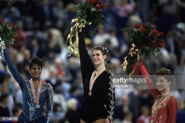 Silver medal winner Debra Thomas of the USA gold medal winner Katarina Witt of East Germany and bronze medal winner Caryn Kadavy of the USA celebrate...