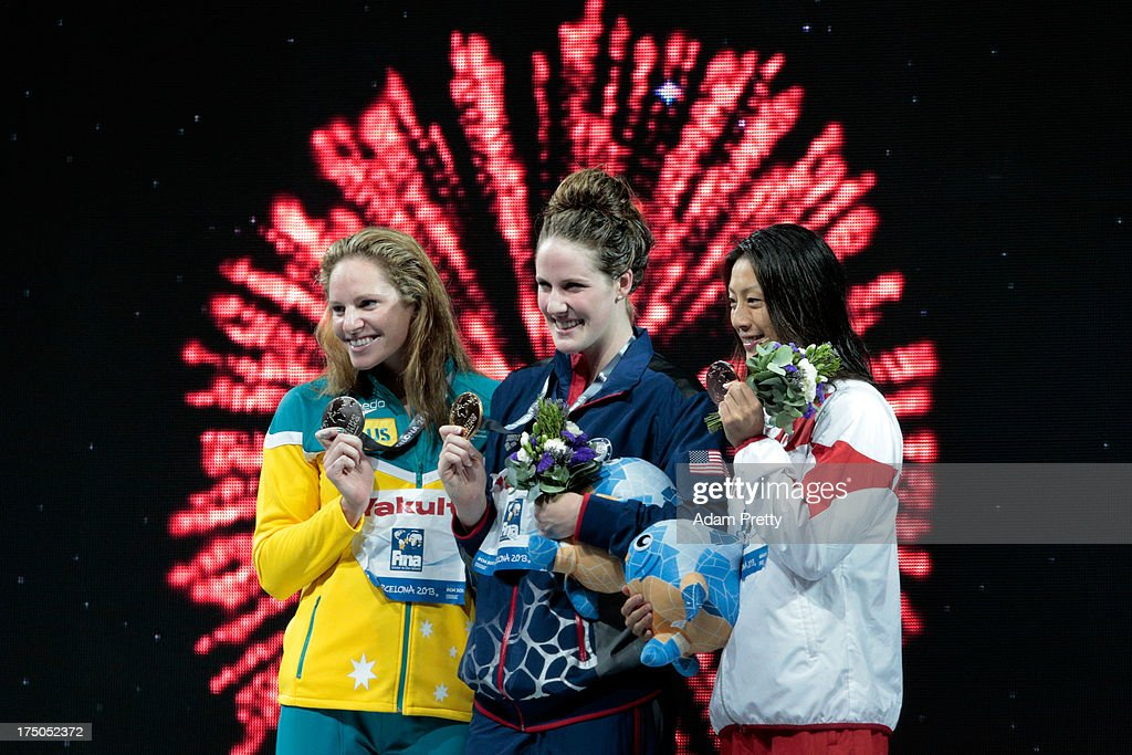Silver medal winner Emily Seebohm, Gold medal winner Missy Franklin of the USA and Bronze medal winner Aya Terakawa of Japan celebrate on the podium after winning the Swimming Women's 100m Backstroke Final on day eleven of the 15th FINA World Championships at Palau Sant Jordi on July 30, 2013 in Barcelona, Spain.