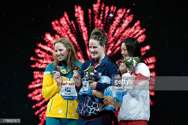 Silver medal winner Emily Seebohm Gold medal winner Missy Franklin of the USA and Bronze medal winner Aya Terakawa of Japan celebrate on the podium...