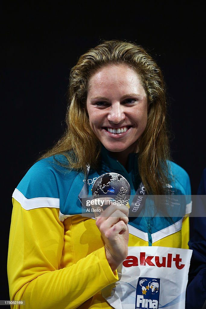 Silver medal winner Emily Seebohm of Australia celebrates on the podium after the Swimming Women's 100m Backstroke Final on day eleven of the 15th FINA World Championships at Palau Sant Jordi on July 30, 2013 in Barcelona, Spain.