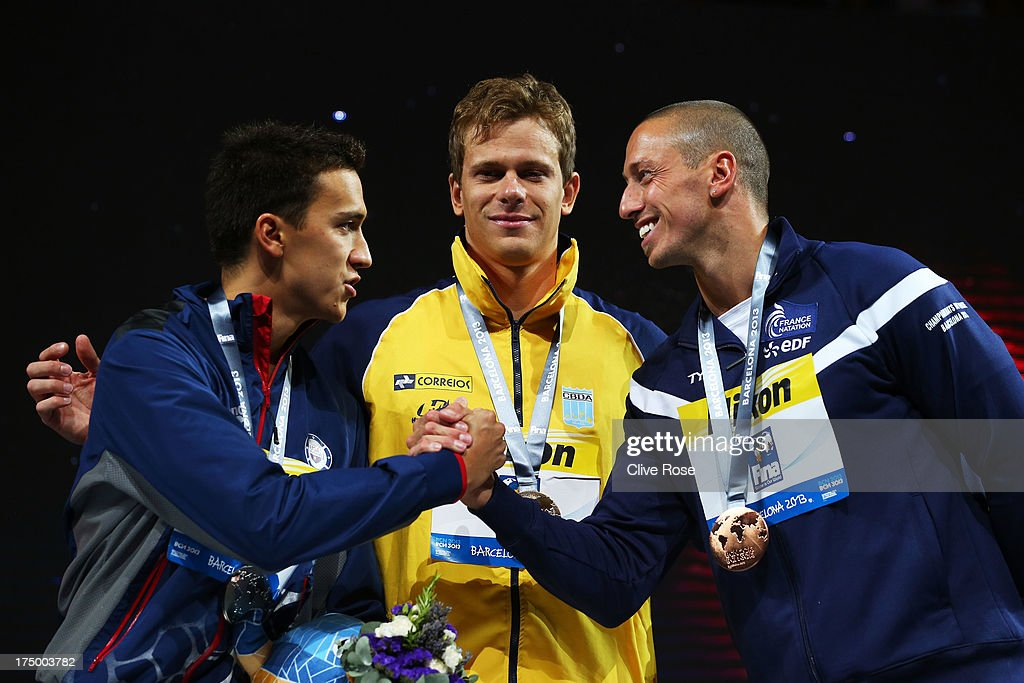 Silver medal winner Eugene Godsoe of the USA, Gold medal winner Cesar Cielo Filho of Brazil and bronze medal winner <a gi-track='captionPersonalityLinkClicked' href=/galleries/search?phrase=Frederick+Bousquet&family=editorial&specificpeople=858929 ng-click='$event.stopPropagation()'>Frederick Bousquet</a> of France celebrate on the podium after the Swimming Men's 50m Butterfly Final on day ten of the 15th FINA World Championships at Palau Sant Jordi on July 29, 2013 in Barcelona, Spain.