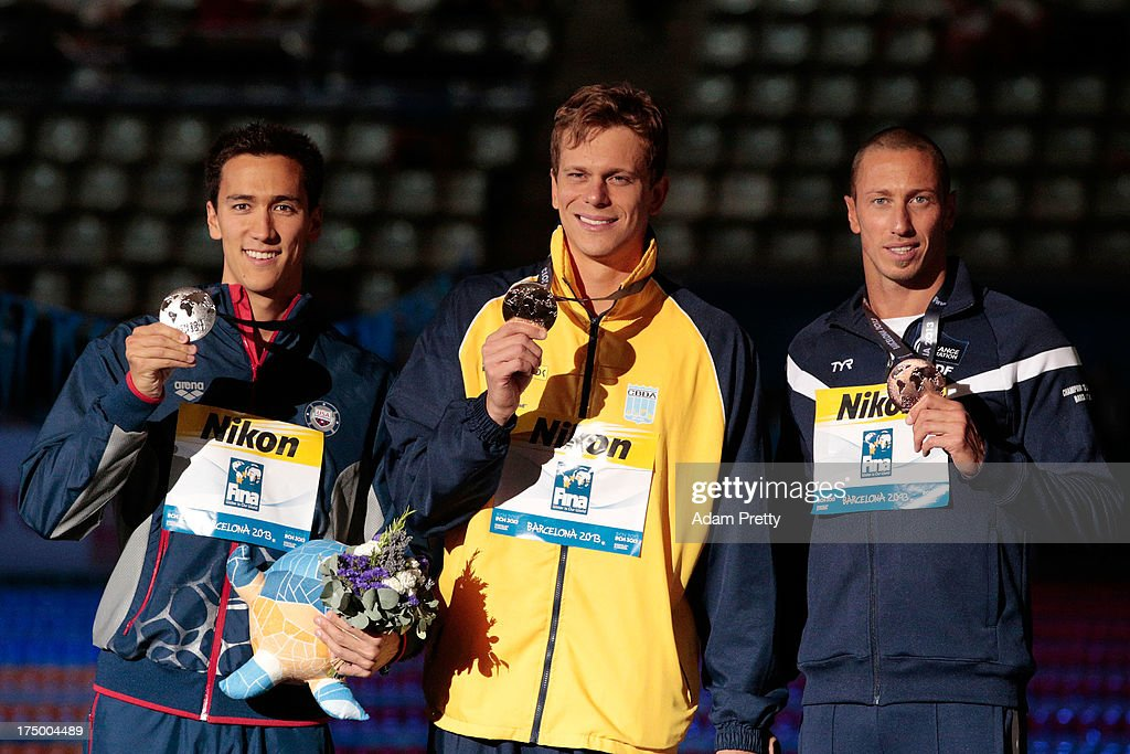 Silver medal winner Eugene Godsoe of the USA, Gold medal winner <a gi-track='captionPersonalityLinkClicked' href=/galleries/search?phrase=Cesar+Cielo+Filho&family=editorial&specificpeople=697764 ng-click='$event.stopPropagation()'>Cesar Cielo Filho</a> of Brazil and bronze medal winner <a gi-track='captionPersonalityLinkClicked' href=/galleries/search?phrase=Frederick+Bousquet&family=editorial&specificpeople=858929 ng-click='$event.stopPropagation()'>Frederick Bousquet</a> of France celebrate on the podium after the Swimming Men's 50m Butterfly Final on day ten of the 15th FINA World Championships at Palau Sant Jordi on July 29, 2013 in Barcelona, Spain.