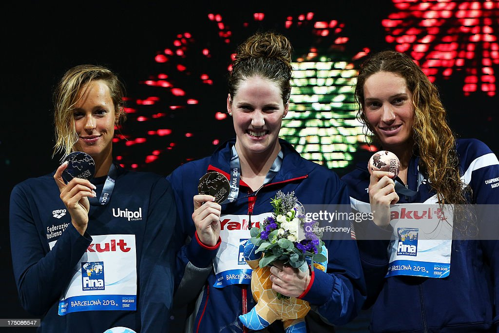 Silver medal winner <a gi-track='captionPersonalityLinkClicked' href=/galleries/search?phrase=Federica+Pellegrini&family=editorial&specificpeople=695870 ng-click='$event.stopPropagation()'>Federica Pellegrini</a> of Italy, Gold medal winner <a gi-track='captionPersonalityLinkClicked' href=/galleries/search?phrase=Missy+Franklin+-+Swimmer&family=editorial&specificpeople=6623958 ng-click='$event.stopPropagation()'>Missy Franklin</a> of the USA and Bronze medal winner <a gi-track='captionPersonalityLinkClicked' href=/galleries/search?phrase=Camille+Muffat&family=editorial&specificpeople=596271 ng-click='$event.stopPropagation()'>Camille Muffat</a> of France celebrate on the podium after the Swimming Women's 200m Freestyle Final on day twelve of the 15th FINA World Championships at Palau Sant Jordi on July 31, 2013 in Barcelona, Spain.