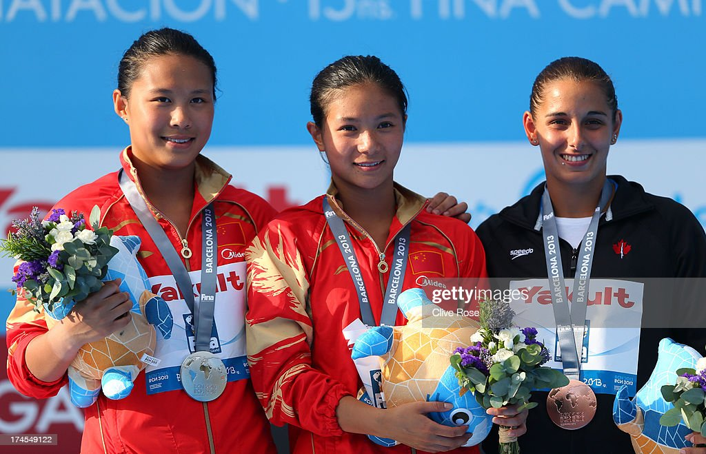 Silver medal winner Han Wang of China, Gold medal winner Zi He of China and Bronze medal winner <a gi-track='captionPersonalityLinkClicked' href=/galleries/search?phrase=Pamela+Ware+-+Diver&family=editorial&specificpeople=6839171 ng-click='$event.stopPropagation()'>Pamela Ware</a> of Canada celebrate after the Women's 3m Springboard Diving Semifinal round on day eight of the 15th FINA World Championships at Piscina Municipal de Montjuic on July 27, 2013 in Barcelona, Spain.