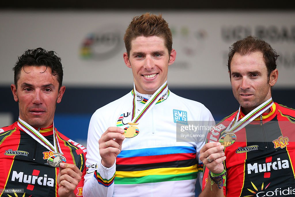 Silver medal winner Joaquin 'Purito' Rodriguez of Spain, gold medal winner and new world champion Rui Costa of Portugal and bronze medal winner <a gi-track='captionPersonalityLinkClicked' href=/galleries/search?phrase=Alejandro+Valverde&family=editorial&specificpeople=193419 ng-click='$event.stopPropagation()'>Alejandro Valverde</a> of Spain pose on the podium after the Elite Men's Road Race, a 272km race from Lucca to Florence on September 29, 2013 in Florence, Italy.