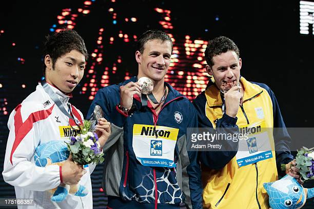 Silver medal winner Kosuke Hagino of Japan Gold medal winner Ryan Lochte of the USA and Bronze medal winner Thiago Pereira of Brazil celebrate on the...