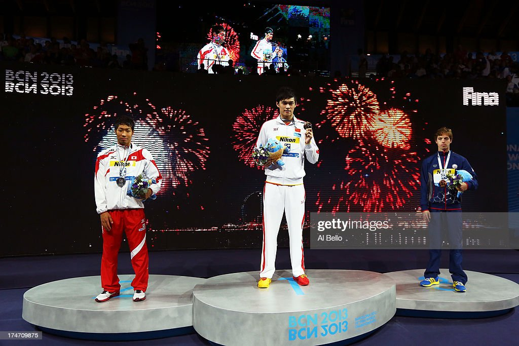 Silver Medal winner <a gi-track='captionPersonalityLinkClicked' href=/galleries/search?phrase=Kosuke+Hagino&family=editorial&specificpeople=7149924 ng-click='$event.stopPropagation()'>Kosuke Hagino</a> of Japan , Gold Medal winner Yang Sun of China and Bronze Medal winner <a gi-track='captionPersonalityLinkClicked' href=/galleries/search?phrase=Connor+Jaeger&family=editorial&specificpeople=9496555 ng-click='$event.stopPropagation()'>Connor Jaeger</a> of the USA celebrate after the Swimming Men's 400m Freestyle Final on day nine of the 15th FINA World Championships at Palau Sant Jordi on July 28, 2013 in Barcelona, Spain.