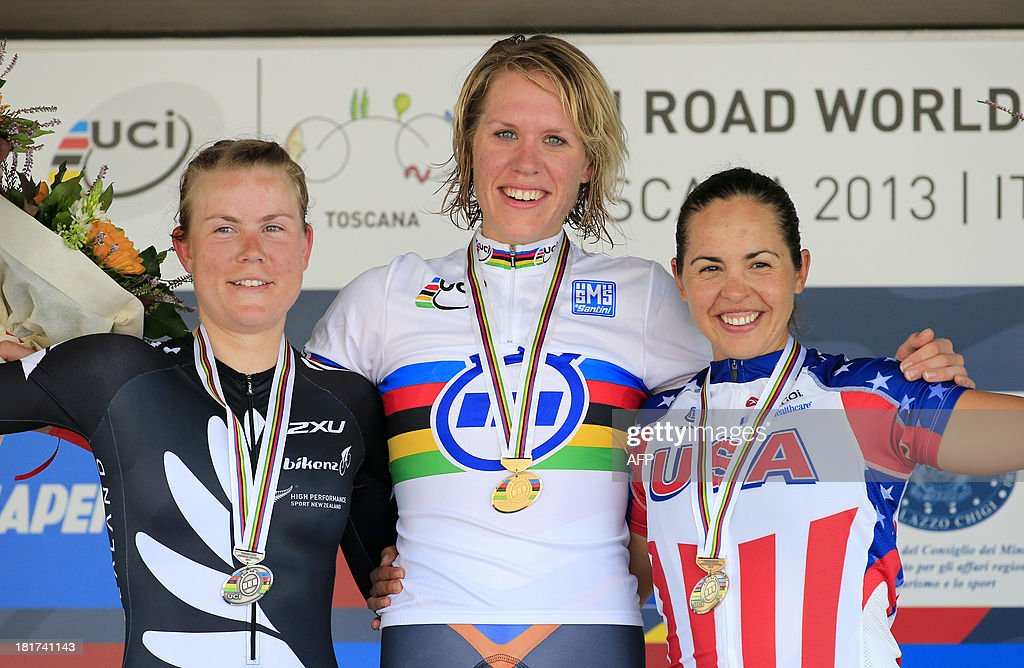 Silver medal winner Linda Villumsen (L) of New Zealand, gold medal winner Ellen Van Dijk (C) of the Netherlands and bronze medal winner Carmen Small of the United States pose on the podium after of the Elite Women's Time Trial of the UCI Road World Championships in Tuscany, on September 24, 2013 in Firenze.