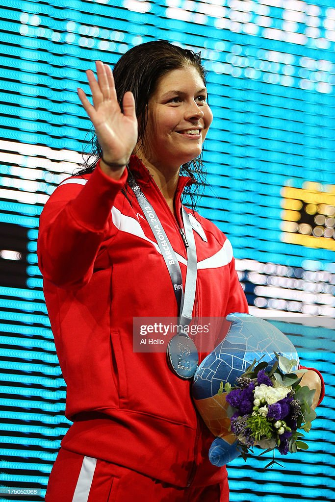 Silver medal winner Lotte Friis of Denmark celebrates on the podium after the Swimming Women's 1500m Freestyle Final on day eleven of the 15th FINA World Championships at Palau Sant Jordi on July 30, 2013 in Barcelona, Spain.