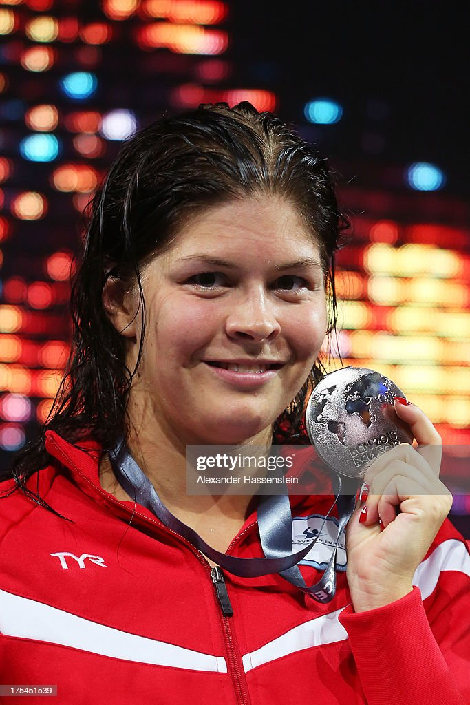 Silver medal winner Lotte Friis of Denmark celebrates on the podium after the Swimming Women's Freestyle 800m Final on day fifteen of the 15th FINA...