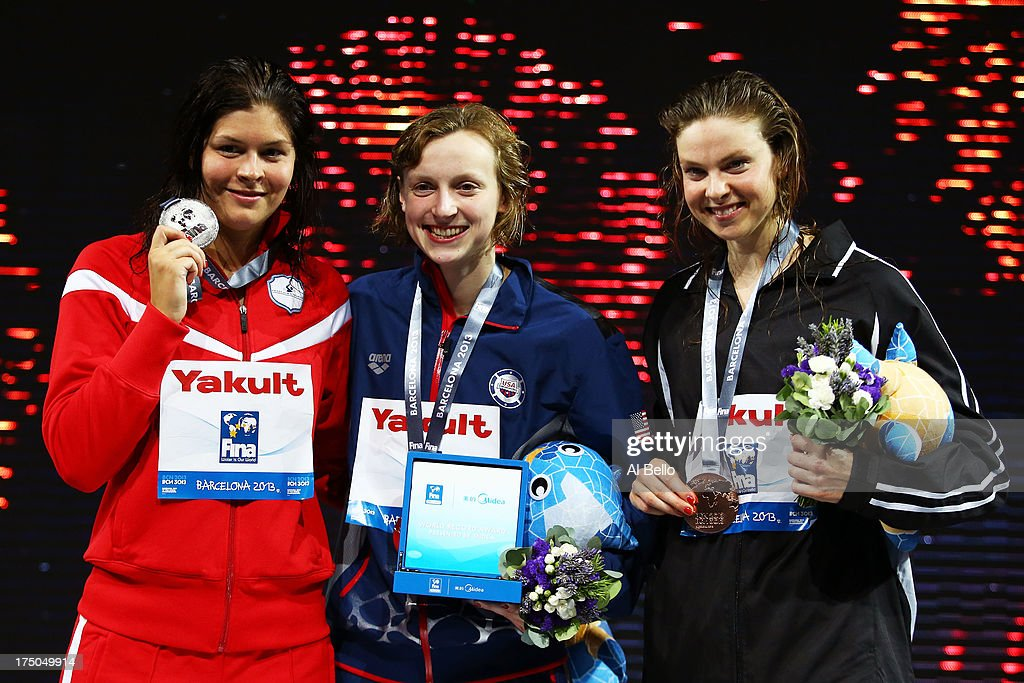 Silver medal winner <a gi-track='captionPersonalityLinkClicked' href=/galleries/search?phrase=Lotte+Friis&family=editorial&specificpeople=3035975 ng-click='$event.stopPropagation()'>Lotte Friis</a> of Denmark, Gold medal winner <a gi-track='captionPersonalityLinkClicked' href=/galleries/search?phrase=Katie+Ledecky&family=editorial&specificpeople=9595921 ng-click='$event.stopPropagation()'>Katie Ledecky</a> of the USA and Bronze medal winner <a gi-track='captionPersonalityLinkClicked' href=/galleries/search?phrase=Lauren+Boyle&family=editorial&specificpeople=802634 ng-click='$event.stopPropagation()'>Lauren Boyle</a> of New Zealand celebrate on the podium after the Swimming Women's 1500m Freestyle Final on day eleven of the 15th FINA World Championships at Palau Sant Jordi on July 30, 2013 in Barcelona, Spain.