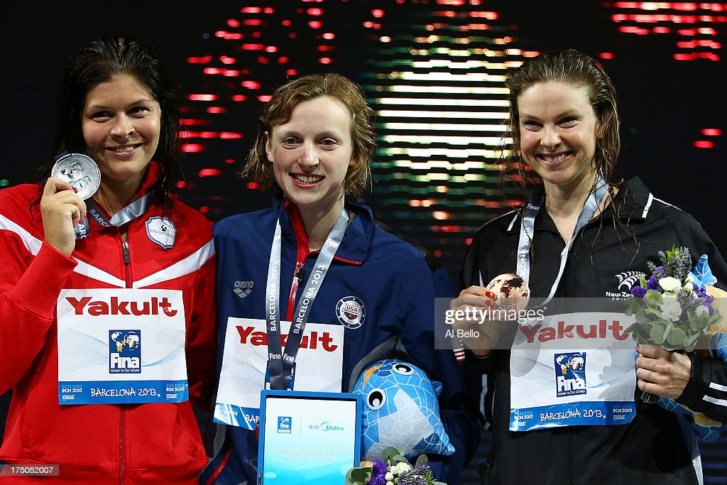 Silver medal winner Lotte Friis of Denmark, Gold medal winner Katie Ledecky of the USA and Bronze medal winner Lauren Boyle of New Zealand celebrate on the podium after the Swimming Women's 1500m Freestyle Final on day eleven of the 15th FINA World Championships at Palau Sant Jordi on July 30, 2013 in Barcelona, Spain.