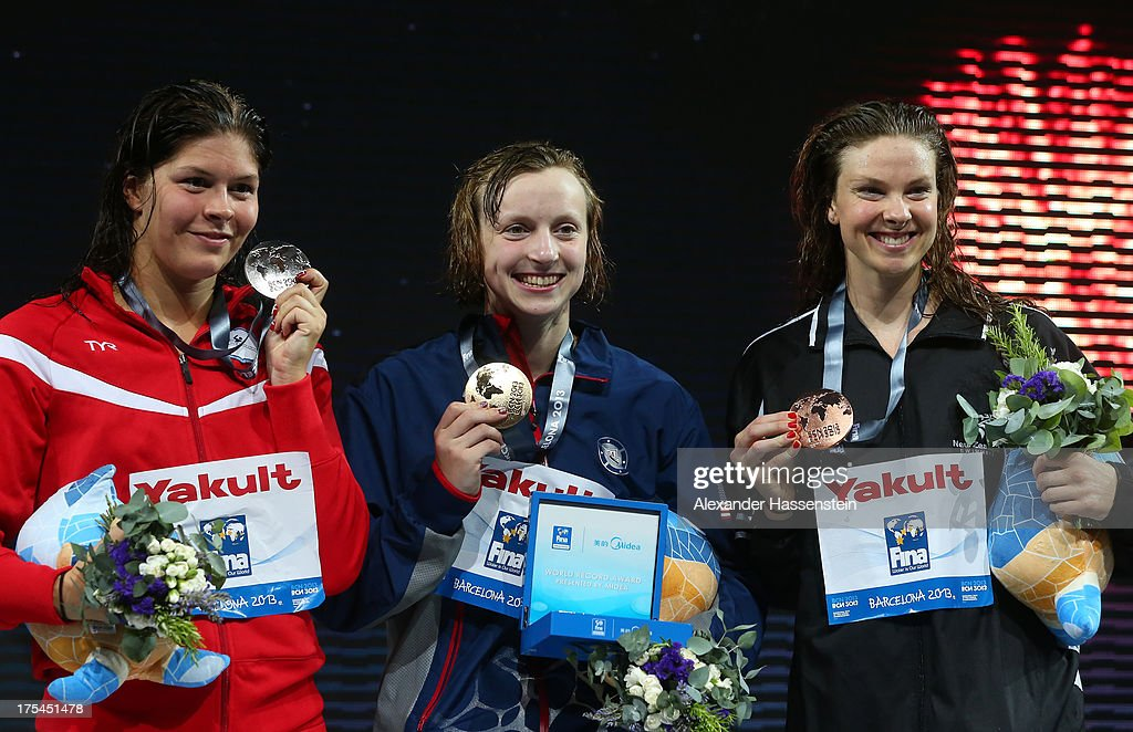 Silver medal winner <a gi-track='captionPersonalityLinkClicked' href=/galleries/search?phrase=Lotte+Friis&family=editorial&specificpeople=3035975 ng-click='$event.stopPropagation()'>Lotte Friis</a> of Denmark, Gold medal winner <a gi-track='captionPersonalityLinkClicked' href=/galleries/search?phrase=Katie+Ledecky&family=editorial&specificpeople=9595921 ng-click='$event.stopPropagation()'>Katie Ledecky</a> of the USA and Bronze medal winner <a gi-track='captionPersonalityLinkClicked' href=/galleries/search?phrase=Lauren+Boyle&family=editorial&specificpeople=802634 ng-click='$event.stopPropagation()'>Lauren Boyle</a> of New Zealand celebrate on the podium after the Swimming Women's Freestyle 800m Final on day fifteen of the 15th FINA World Championships at Palau Sant Jordi on August 3, 2013 in Barcelona, Spain.