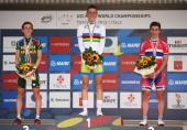 Silver medal winner Louis Meintjes of South Africa gold medal winner and new World Champion Matej Mohoric of Slovenia and bronze medal winner Sondre...